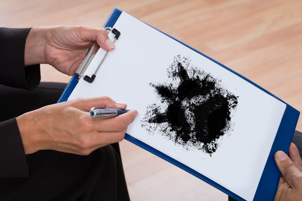Psychologist Showing Rorschach Inkblot To Patient